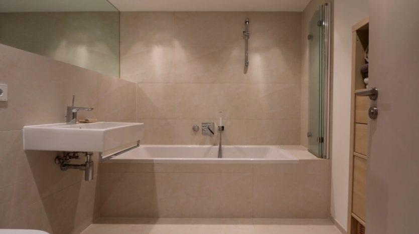 Spacious bathroom with a bathtub