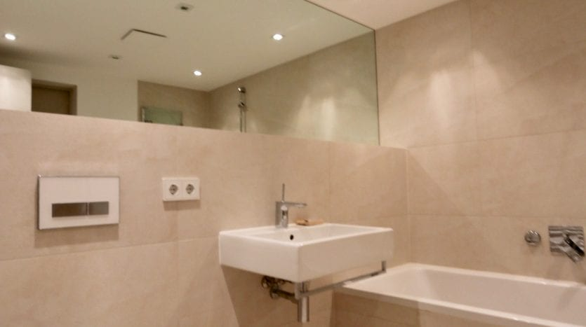 Bathroom with a large mirror